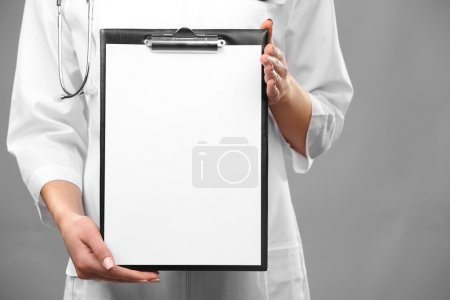Doctor with paper holder