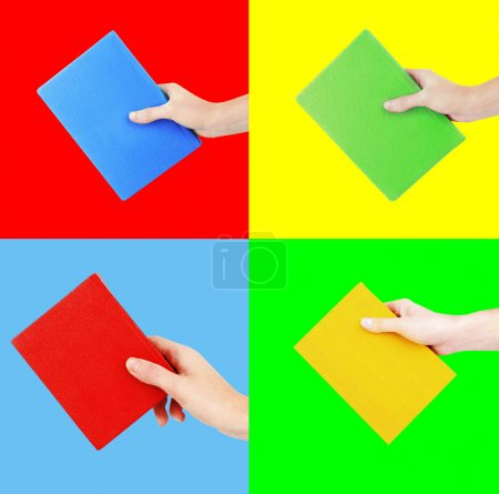 Woman hands holding color books