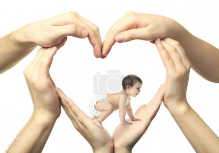 Baby girl crawling in heart-shaped hands