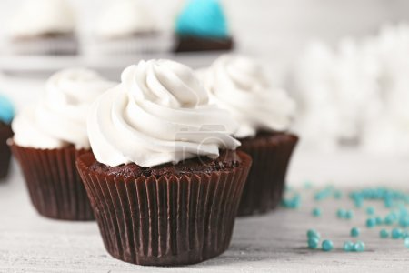 Photo for Tasty Cupcakes on wooden table - Royalty Free Image