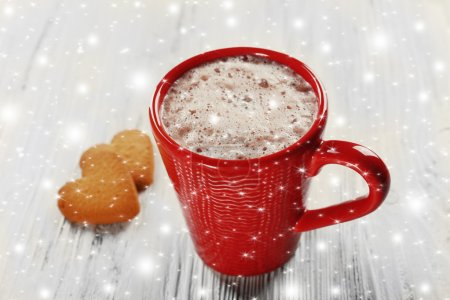 Red cup of hot cacao and cookies