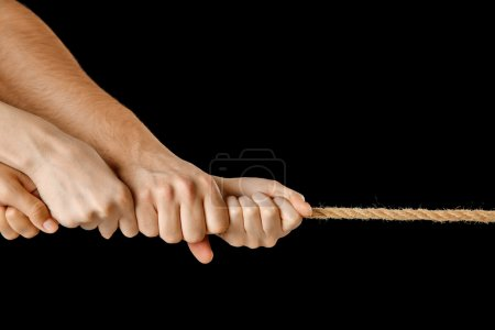 People hands pulling the rope