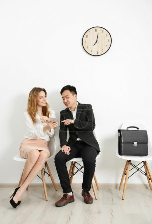 Man and woman waiting for interview