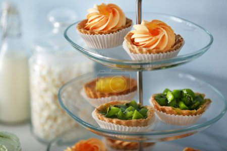 Photo for Delicious desserts  on a glass stand - Royalty Free Image