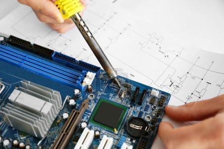 Photo for Man hands repair computer parts - Royalty Free Image