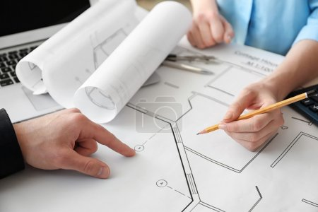 Engineers working with blueprints