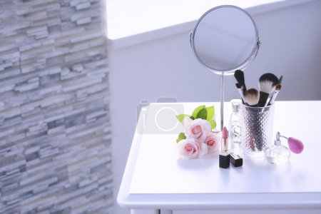 Cosmetic set on dressing table