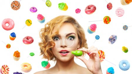 Photo for Beautiful girl with colorful lollipops , donuts and cupcakes on light background - Royalty Free Image