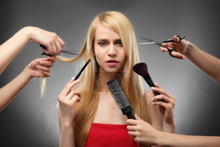 Hairdressers making new style for  woman