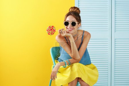 Photo for Beautiful girl with candy on color background - Royalty Free Image