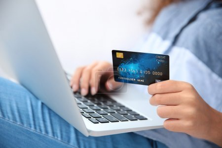 hands using credit card