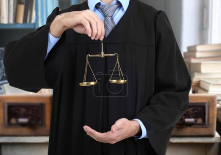 Judge holding scales of justice