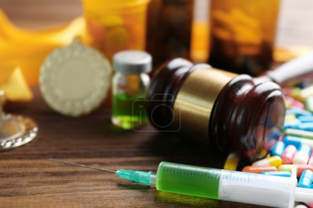 Photo for Syringe with pills, medal and gavel. Doping in sport concept - Royalty Free Image