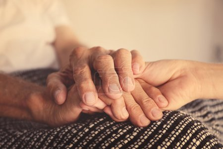 Old male and young female hands