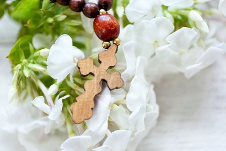 Wooden cross with flowers