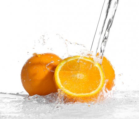 Fresh oranges in splashing water isolated on white