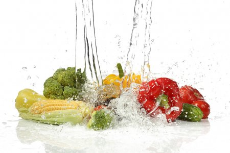 Vegetables with  splashing water