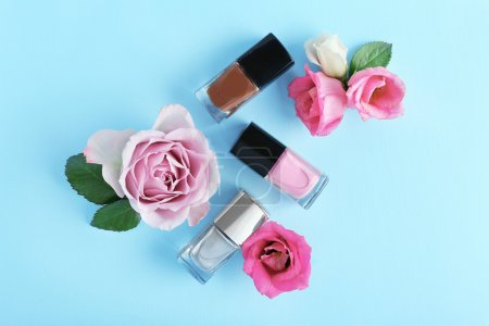 Nail polishes and flowers