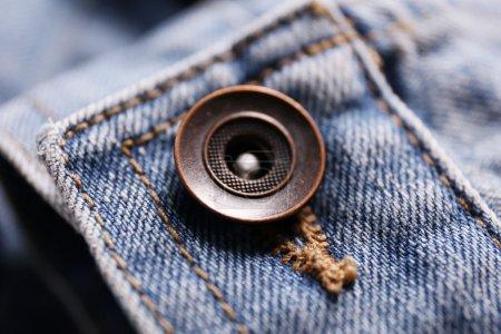 Button on a denim cloth