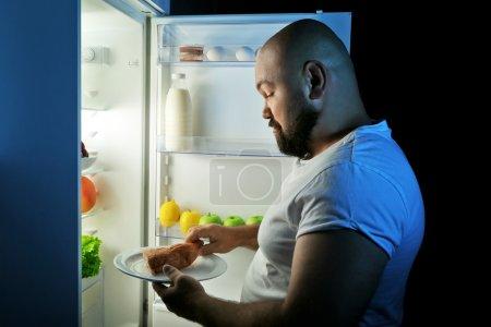 man taking food