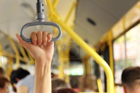 Hand holding handle