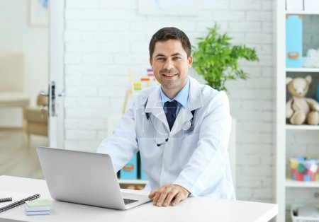 Pediatrician working at his office