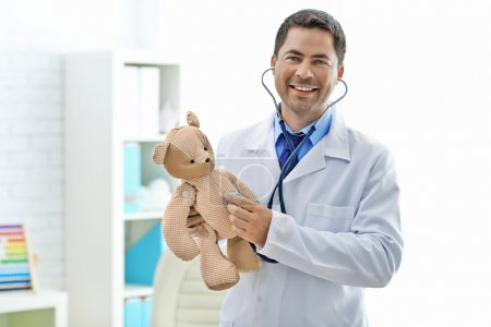 Pediatrician with stethoscope at his office