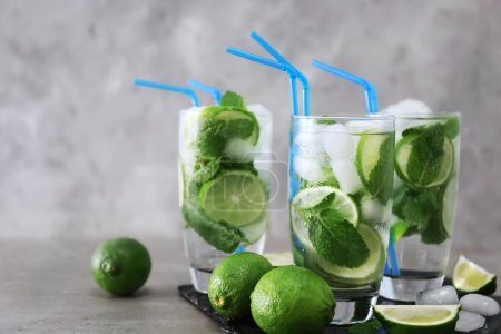 Photo for Cold fresh cocktails with lime on table - Royalty Free Image