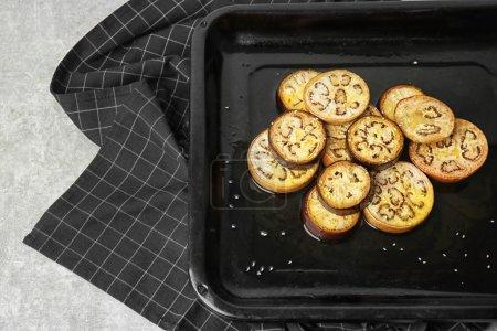 Sliced eggplant on baking tray