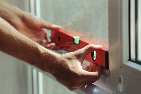 worker installing window