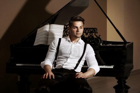 Photo for Handsome musician with piano - Royalty Free Image