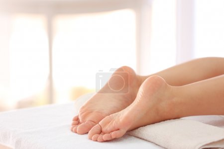 Female feet in spa salon