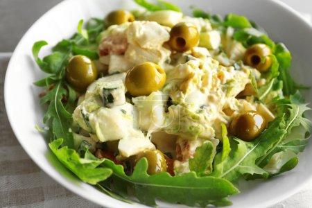 Tasty fresh salad on plate, close up
