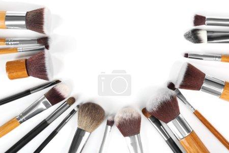 Make up brushes on white background