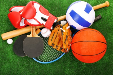 Sports equipment on grass background