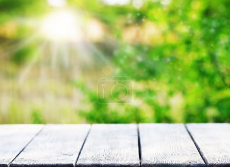 Wooden table on bright background