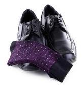 černé Pánské boty a ponožky izolovaných na bílém