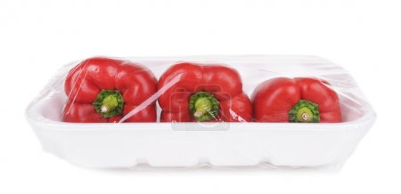 Pepper packed in food film isolated on white