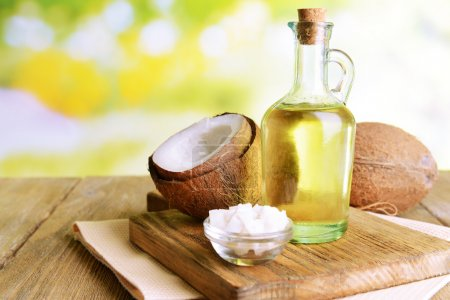 Coconut oil on table on light background