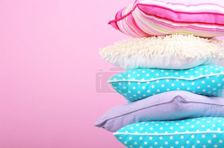 Photo for Bright pillows on pink background - Royalty Free Image