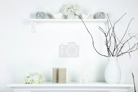 Photo for Different objects on white shelf in living room - Royalty Free Image
