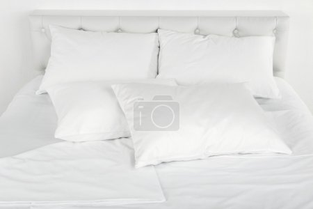 White pillows on bed close up