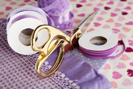 Ribbons with scissors and fabrics