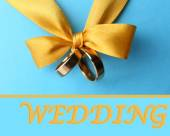 Wedding rings tied with ribbon