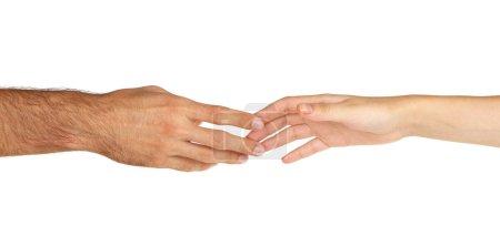 Photo pour Les femmes et les hommes main attirés les uns aux autres isolé sur blanc - image libre de droit