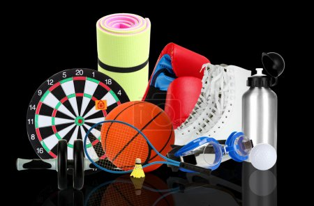 Photo for Sporting goods on black background - Royalty Free Image