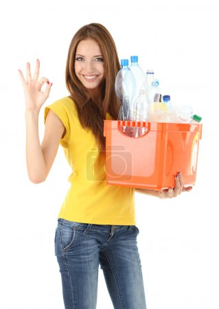 Young girl sorting plastic bottles isolated on white