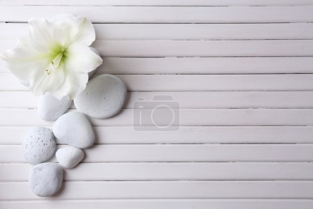 Spa stones on wooden table