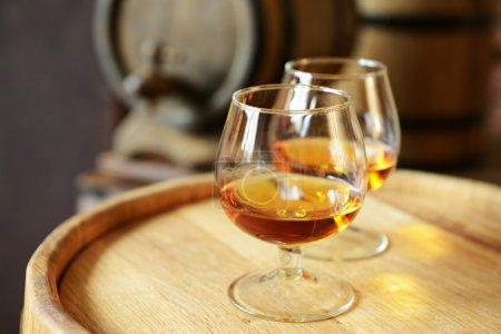 Glasses of brandy in cellar