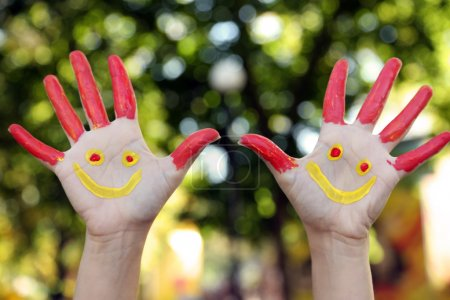 Photo for Smiling colorful hands on natural background - Royalty Free Image